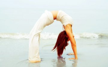 backbend woman yoga beach